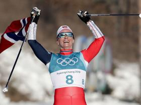 Winter Olympics 2018: Marit Bjoergen wins women's 30 km cross-country title, becomes only five-medal athlete at Pyeongchang