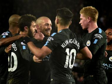 Premier League: Manchester City thrash Swansea to set new 15-win record; United scrape past Bournemouth