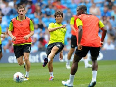 Manchester City's Spanish midfielder David Silva (second from left) attends a training session at The City of Manchester stadium, Manchester, north-west England on August 3, 2011. AFP