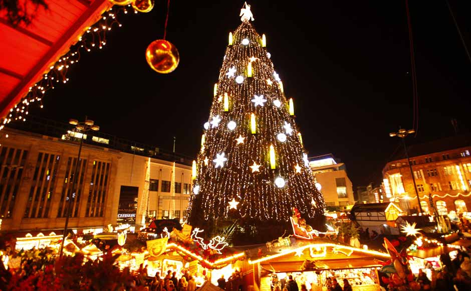 A decorated Christmas tree is lighted up at a Christmas market on its opening day in Dortmund.The Christmas tree of Dortmund is the largest in the world and is built with a scaffold, covered with 1,700 Norway spruces, 40,000 lights and is 45m (148 ft) high. Reuters