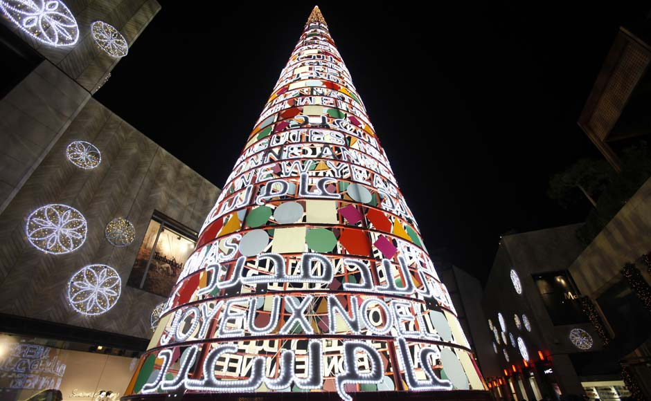 "A Christmas tree with words ""Merry Christmas and Happy New Year"" in many languages is erected for the upcoming Christmas at Beirut. Reuters"