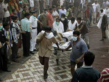 Local TV channels said 65 bodies have been recovered from the AMRI hospital fire in Kolkata. Bikas Das/AP
