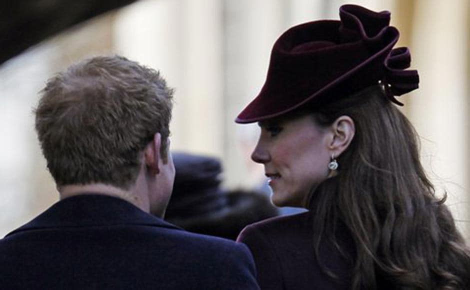Kate, Duchess of Cambridge, right, speaks with Britain's Prince Harry as they arrive arrive to attend a Christmas Service with other members of the royal family. AP