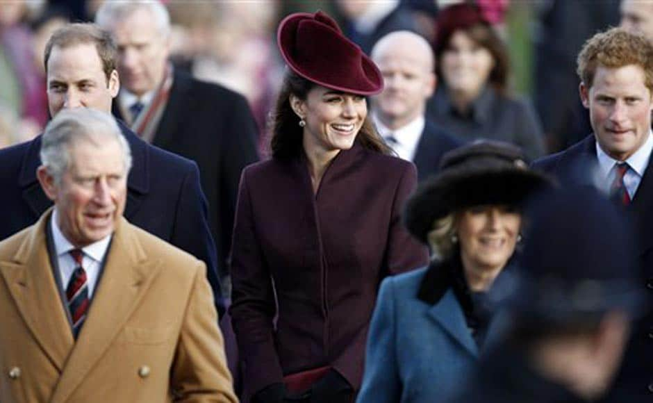 Britain's Prince William, back left, Prince Charles, front left, Kate Duchess of Cambridge, center, Camilla Duchess of Cornwall, foreground right, and Prince Harry, back right, arrive to attend a Christmas Service at St Mary's church on the grounds of Sandringham Estate, the Queen's Norfolk retreat, England. AP