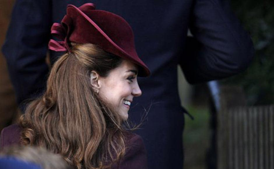 Kate, Duchess of Cambridge, follows her husband Prince William, as they arrive to attend a Christmas Service with other members of the royal family. AP