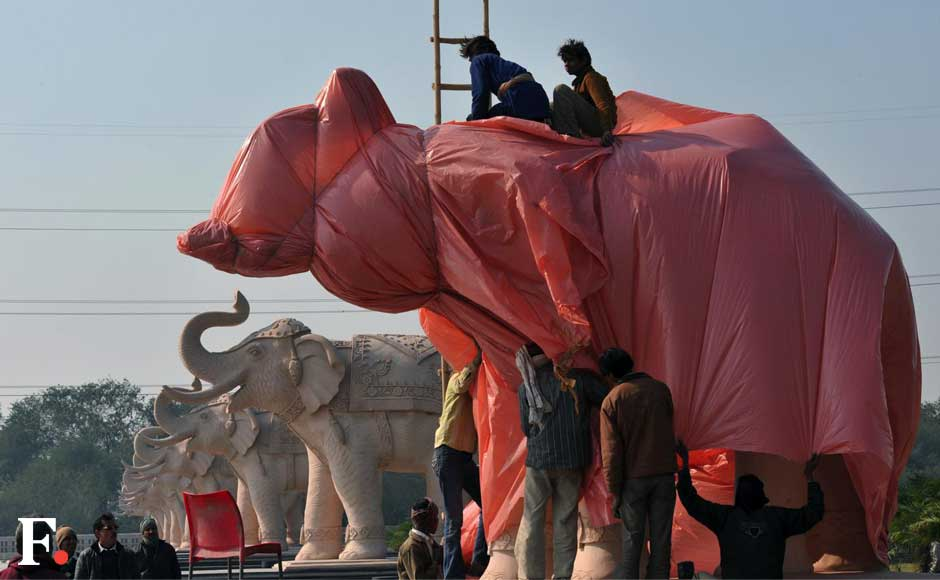 Authorities in Lucknow and Noida have started draping statues of Uttar Pradesh chief minister and the elephant, the symbol of her Bahujan Samajwadi Party (BSP). Naresh Sharma/ Firstpost