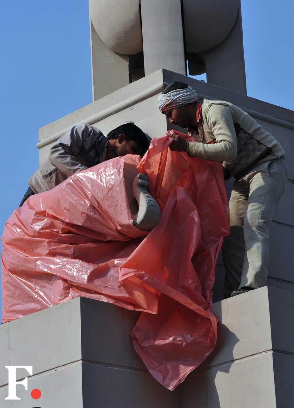 The EC had ordered all statues of the UP chief minister and her party symbol installed at several places in UP to be covered until the Assembly poll were over in the state. Naresh Sharma/ Firstpost