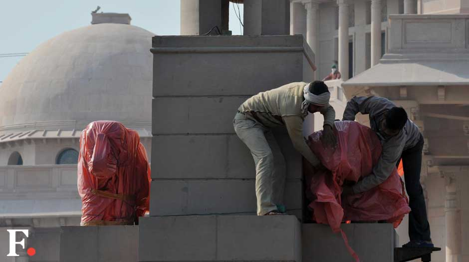 The elephants are being draped in pink plastic. Naresh Sharma/ Firstpost