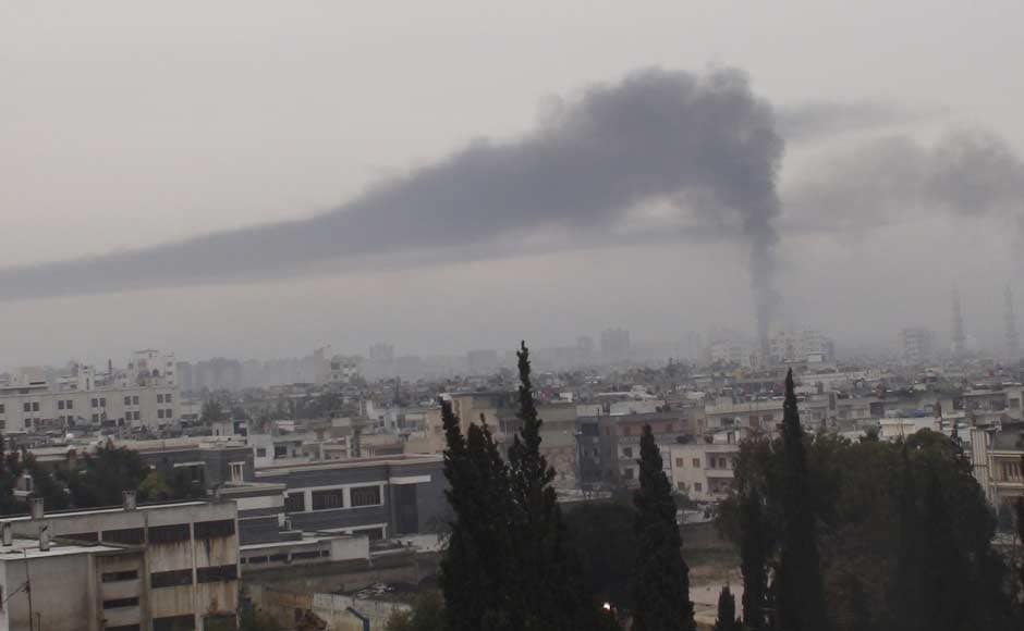 Smoke billows in Homs in this handout picture received February 17. Reuters