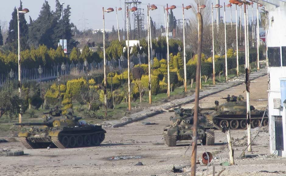 Syrian tanks are seen in Bab Amro near the city of Homs. Reuters