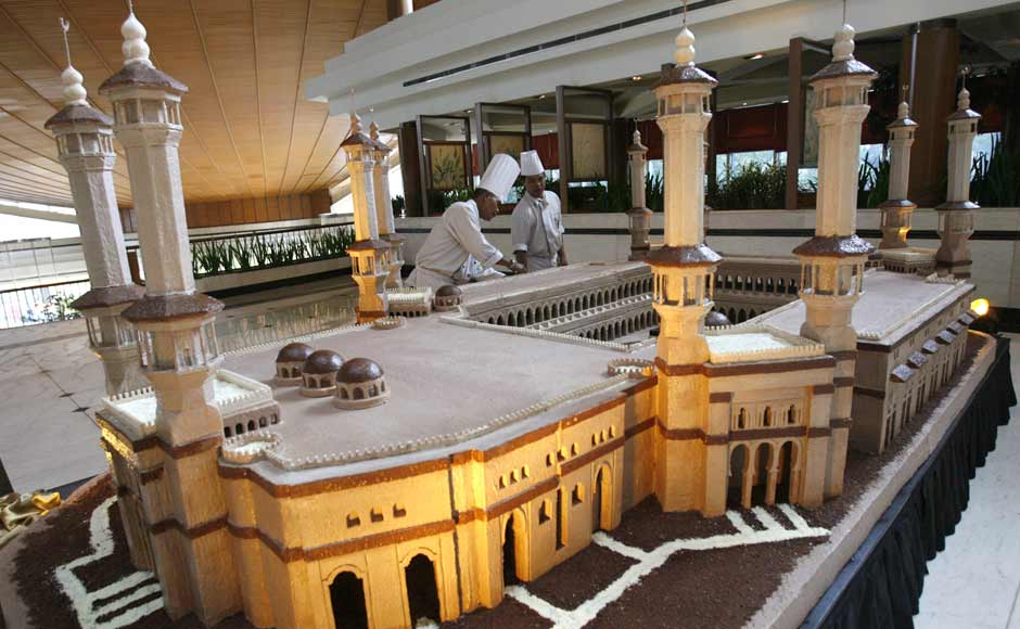 Chefs put finishing touches to a chocolate model of the Grand Mosque in a luxury hotel in Jakarta in this photo dated 16 September 2007. The chocolate sculpture, measuring 2.5 metres by 5 metres, was made from 150 kg of chocolate. Reuters