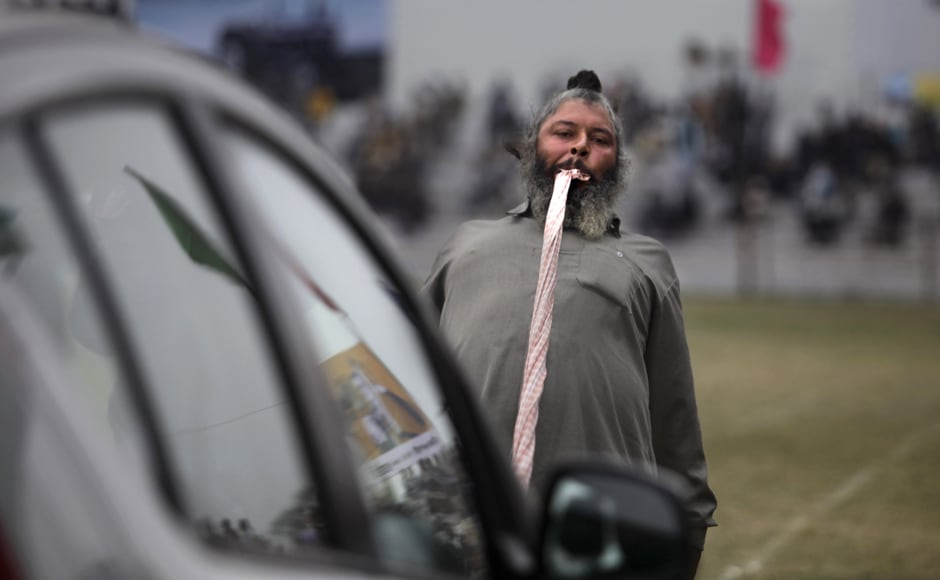 "He's got teeth! An Indian villager pulls a car with his teeth during the ""Indian Rural Olympics"", in Kila Raipur, near Ludhiana. AP"