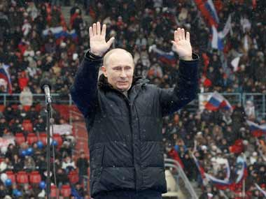 Putin warns against foreign influence as thousands rally in support
