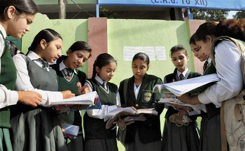 12th standard students giving a last look to their notes as they prepare to appear in their CBSE exams at an examination centre in Moradabad on Thursday. PTI