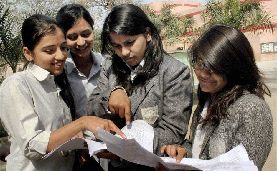 Students discuss the paper after appearing in their 12th standard exam of CBSE board in New Delhi on Thursday.PTI