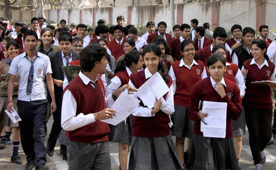 Students leave after appearing in the 12th standard exam of CBSE board in Gurgaon on Thursday. PTI