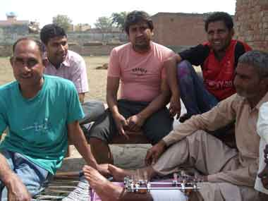 Residents of Bhatta village say that while they support the Congress they are disappointed with the party. Pawan Kumar (left), Naveen Chaudhury (third from left), Rahul Kaushik (fourth from left) and Shouhin Khan (right) - with steel rods on his leg after it was hit by a bullet during the police firing on agitating farmers in May. Naresh Sharma/Firstpost