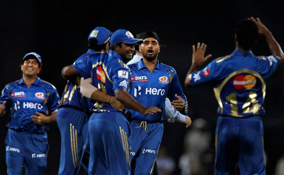 Harbhajan and other MI players celebrate another wicket. PTI