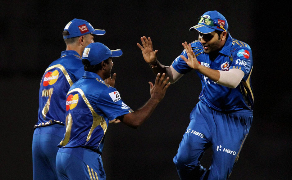 MI players celebrate another wicket. PTI