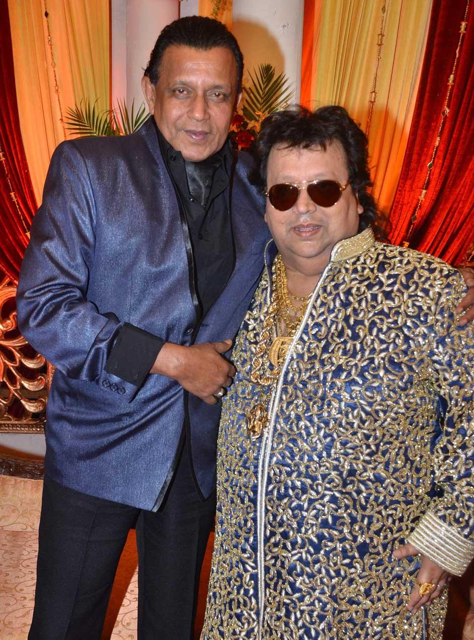 Mithun Chakraborty with Bappi Lahiri at his son's wedding reception.