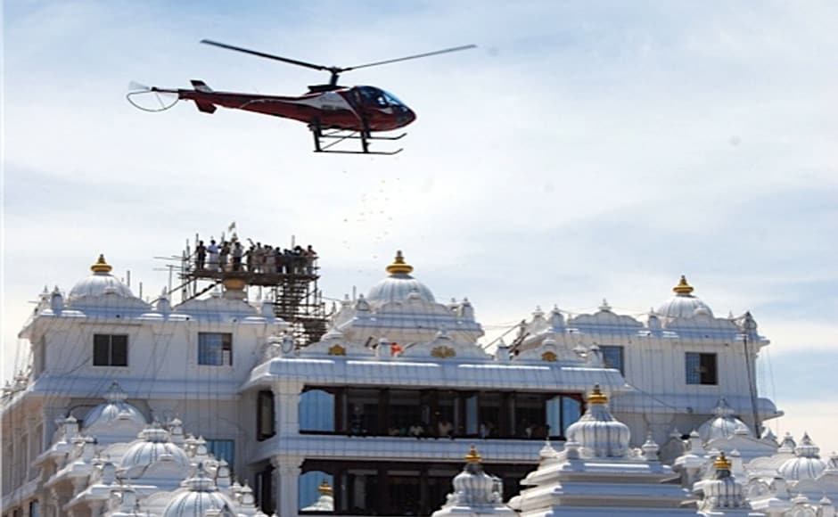 A helicopter showering flowers on the temple at the consecration ceremony. Firstpost