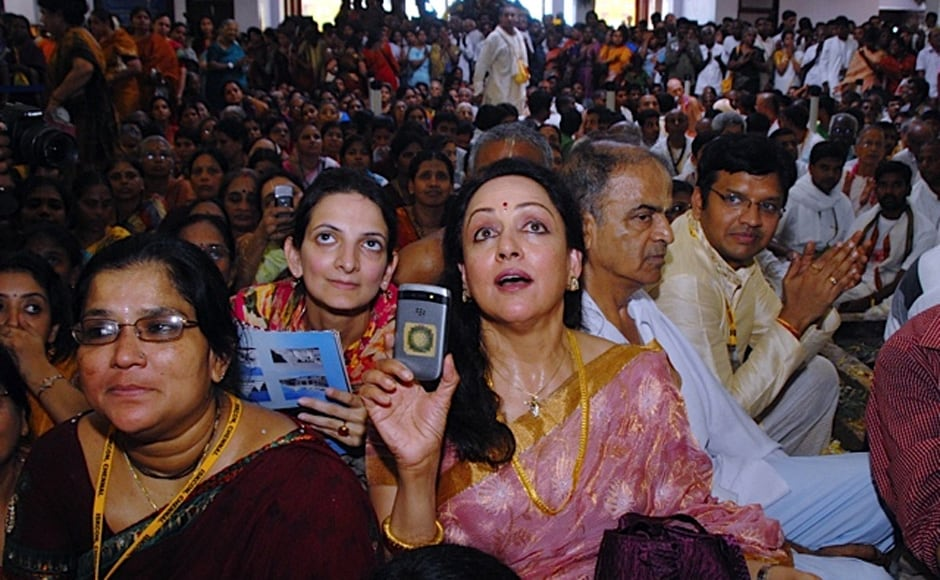The 'dream girl' Hema Malini takes pictures during celebrations at ISKCON temple. Firstpost