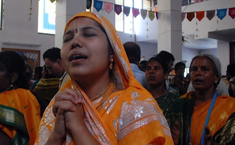 Devotees praying at the temple. The temple was consecrated on 26th April. Firstpost