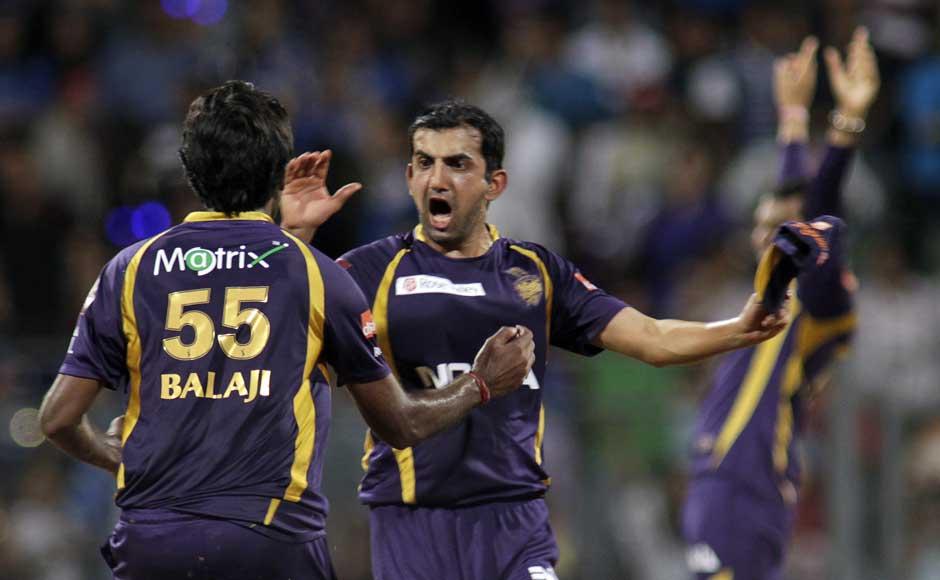 Kolkata Knight Riders' Gautam Gambhir, right,  and L Balaji celebrates after their team won the match against Mumbai Indians. AP