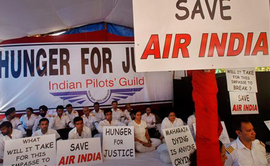 Air India pilots who have been on strike since 7 May and pledging their allegiance to the Indian Pilots Guild participate in a hunger strike against Air India's management in Mumbai. AP