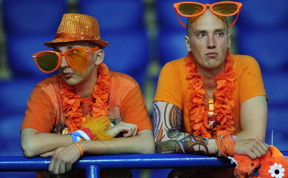 Flying down from Hawaii was a big mistake: Dutch fans react after the Euro 2012 soccer championship Group B match between the Netherlands and Germany. AP