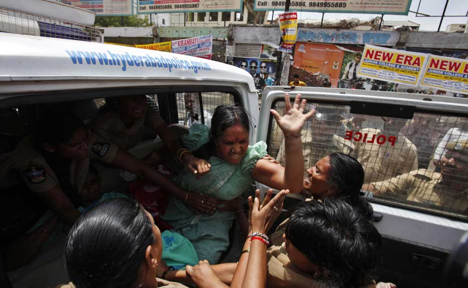 I'm so angry even five of you can't detain me:A left party activist beats a police woman as she is detained during a nationwide strike against a steep hike in gas prices in Hyderabad. Mahesh Kumar A/AP