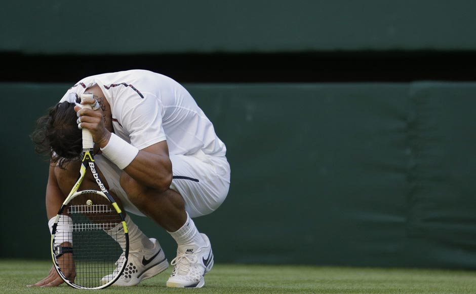 Nadal reacts after losing a point. AP
