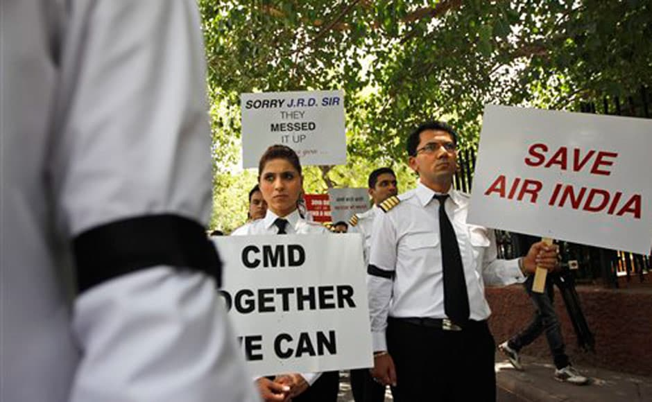 On the 30th day of the Air India strike, pilots participate in a silent protest march against Air India's management. AP