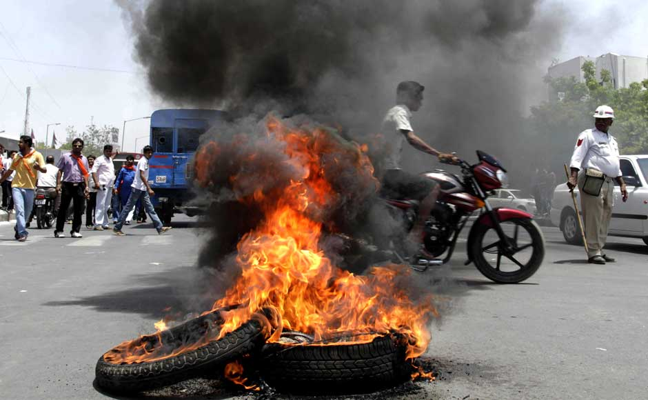 We not only deflating the tyres, we're burning them as well. Good way to ensure that buses don't run: Burning tires set ablaze by India's opposition Bharatiya Janata Party (BJP) activists as they attempt to block traffic during a nationwide strike to protest a steep hike in gas prices in Ahmedabad. Ajit Solanki/AP