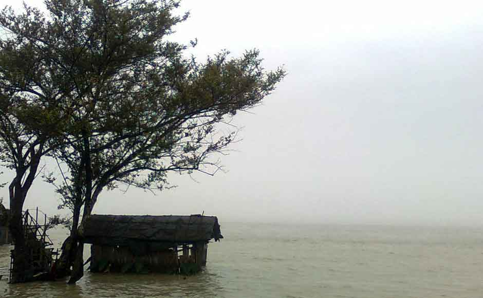 A thatched hut ravaged by the Brahmaputra in Dibrugarh district of Assam on Tuesday. Image courtesy Alok Kar Dowerah