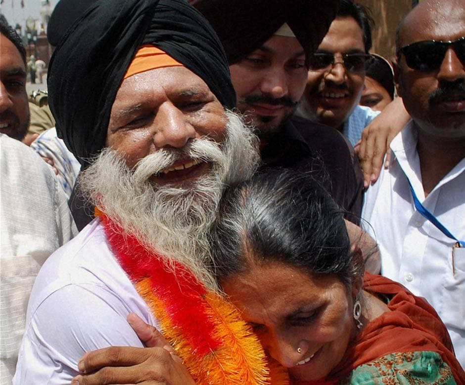 Surjit Singh hugs his daughter Parminder Kaur on his arrival at Attari-Wagah border. PTI