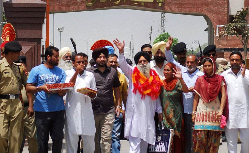 Surjit Singh is greeted by his family and relatives on his arrival at the Indian side of Attari-Wagah border on Thursday after being released by the Pakistani authorities. PTI