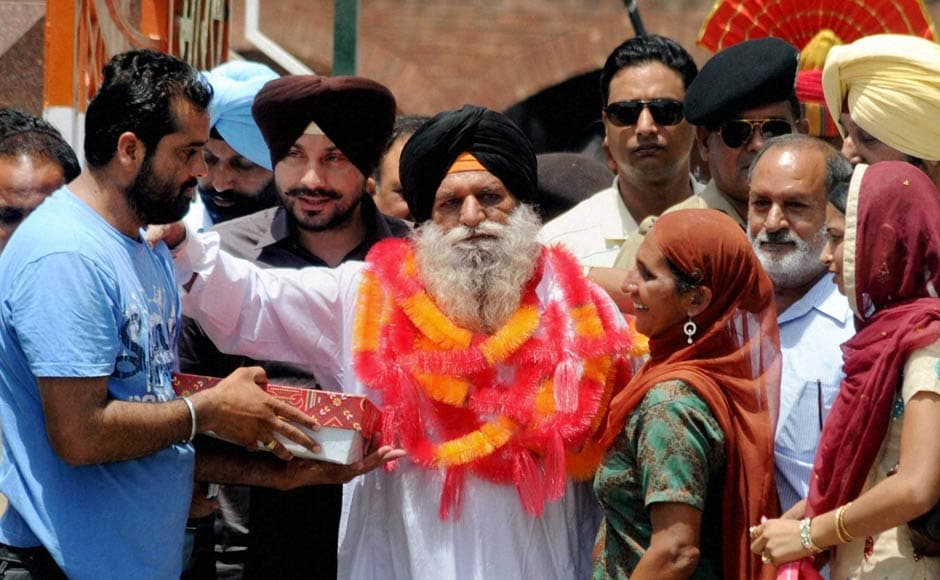 Surjit Singh is greeted by his family and relatives on his arrival at the Indian side of Attari-Wagah border after being released by the Pakistani authorities. PTI