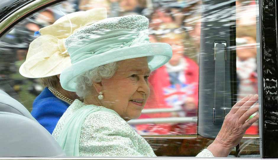 Britain's Queen Elizabeth leaves Buckingham Palace to attend the service of thanksgiving to mark the Diamond Jubilee at St Paul's Cathedral in central London. AP
