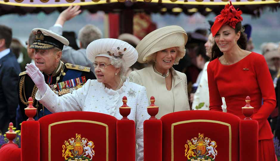 Britain's Queen Elizabeth (2nd L) waves, with Prince Philip (L), Camilla, Duchess of Cornwall (2nd R) and Catherine, Duchess of Cambridge, from the Spirit of Chartwell during the Diamond Jubilee River Pageant on the River Thames, in London. Reuters