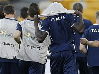 Italy's Balotelli puts on a bib during a training session at the Olympic Stadium in Kiev. Reuters