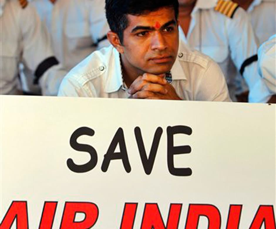 An Air India pilot who has been on strike with his colleagues since 7 May participates in the hunger strike. AP