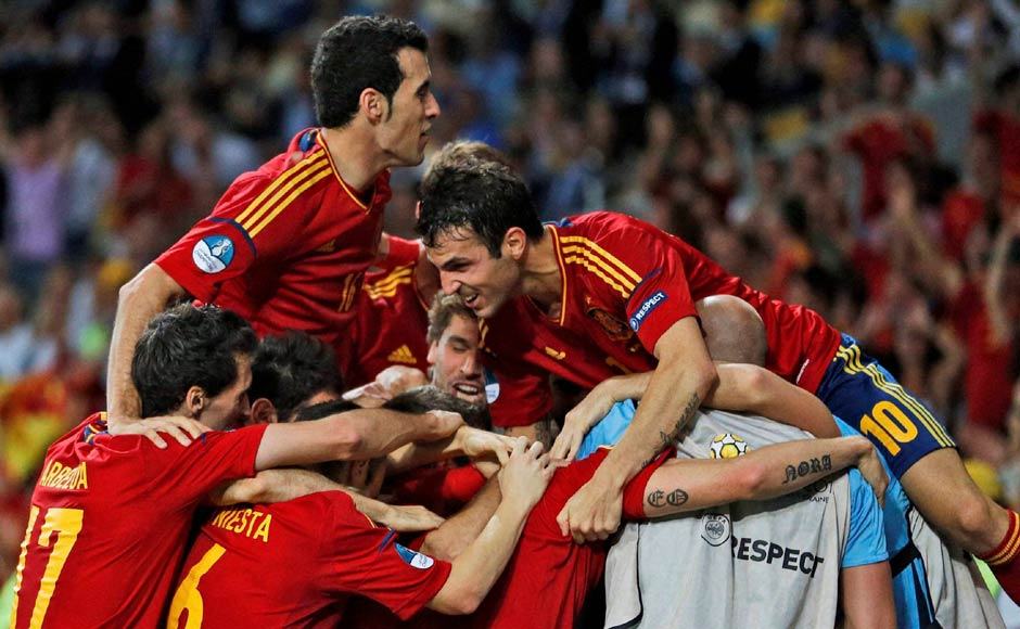 Spanish players celebrate their win. AP