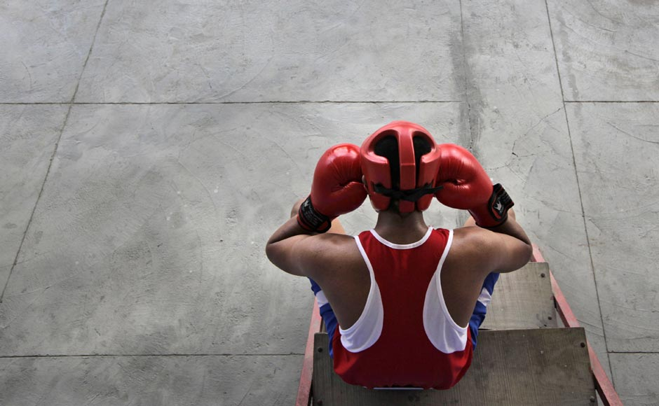 An amateur boxer takes a break during a practice session at the Bhiwani Boxing Club in Bhiwani, 122 kilometers west from New Delhi. The sleepy northern Indian town of Bhiwani is considered a mini Cuba, with dozens of boxers fighting it out hard in top national and international competitions.AP
