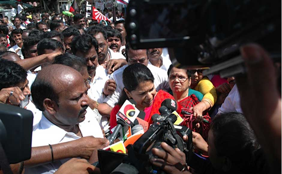 """Kanimozhi courting arrest at Saidapet in the city as part of the DMK's """"Fill the Jail"""" agitation. Firstpost"""