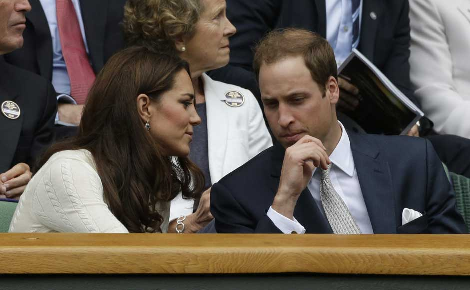 Britain's Prince William, right, and his wife Kate, Duchess of Cambridge applaud ahead of a quarterfinals match between Roger Federer of Switzerland and Mikhail Youzhny of Russia.AP