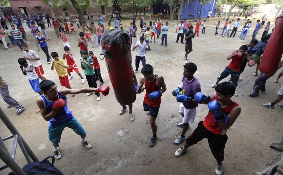 Amateur boxers take part in a training session at the Sports Authority of India complex in Bhiwani.   AP