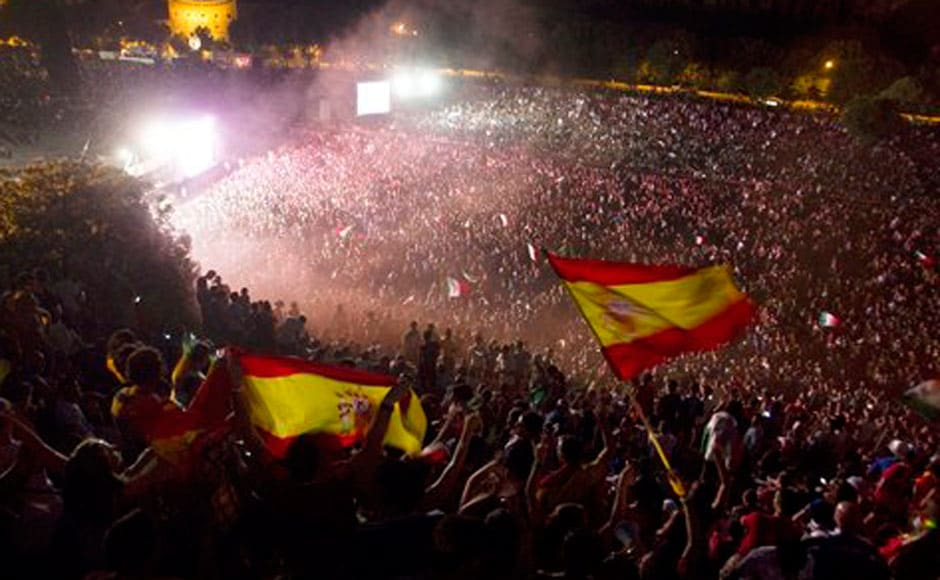 Spanish fans celebrate the victory. AP