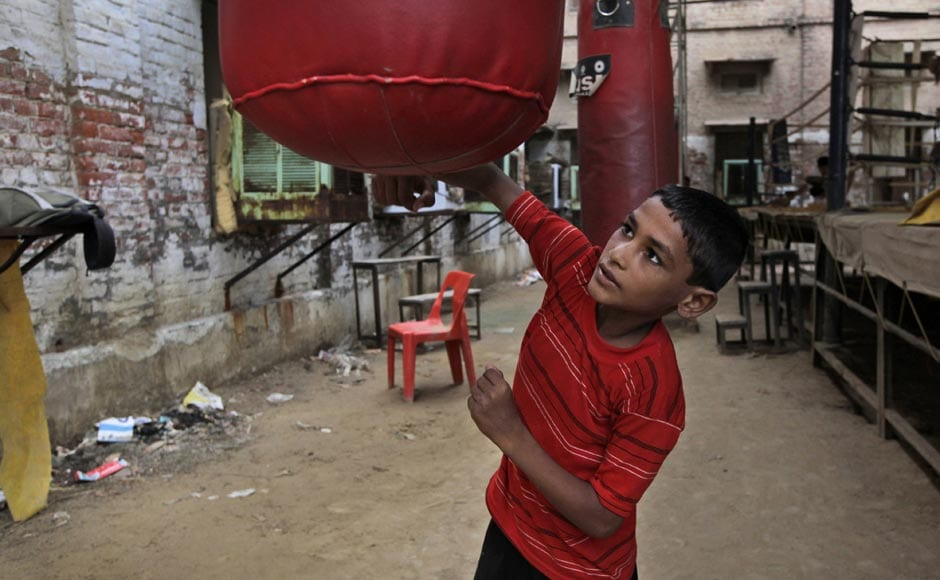 Rahul, a 10-year-old boxing trainee, practices with a punching bag at the Sports Authority of India complex in Bhiwani. AP