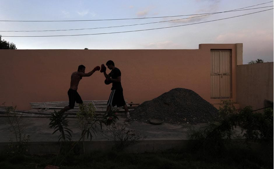 A boxer practices punching at the Bhiwani Boxing Club in Bhiwani.AP
